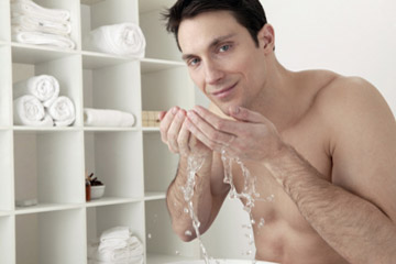 Man washing face.