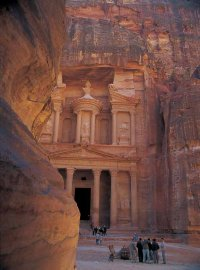 The tombs ad temples of Petra, carved out of the cliffs themselves, appear suddenly.