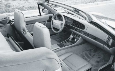 The Porsche 968 cabrio was effectively a two-seater -- the back seat was replaced with a carpeted parcel shelf.