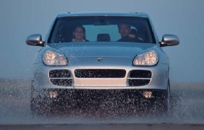 Porsche Cayenne front view driving in water