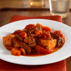 Tender pot roast with red potatoes and carrots in a savory tomato sauce