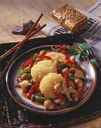 Sizzling Rice Cakes with Mushrooms and Bell Peppers