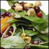 Salad of Arugula, Pomegranate, Persimmon and Toasted Hazelnuts