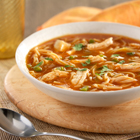 Richly flavored chicken and fideo soup with tomato sauce and poblano and jalapeño peppers