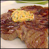 Grilled T-Bone Steaks with Chipotle and Cilantro Butter