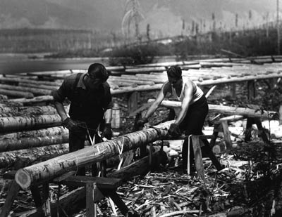 Workers peeling logs in 1933