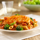 Chicken breasts, simmered in tomato sauce, served with pasta and broccoli tossed with a creamy tomato-pesto sauce