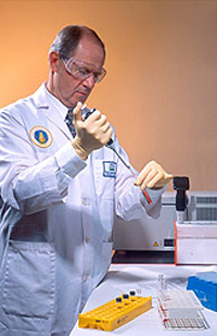 Chemist prepares blood samples for analysis