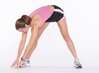 Stretch down toward right foot by bending at waist, hold 5 to 10 seconds.