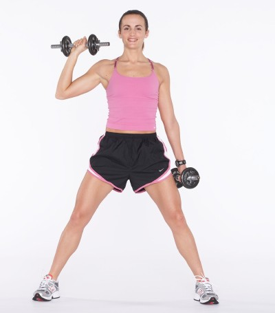 Trace a diagonal line across body with right arm, bringing the dumbbell towards your right shoulder.