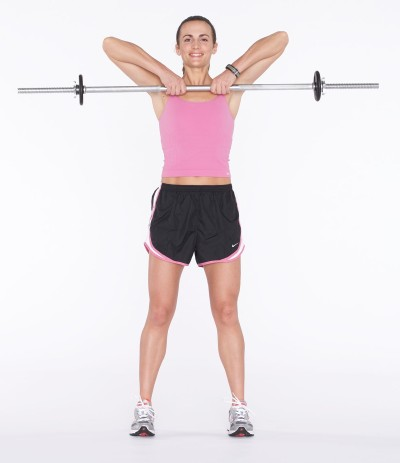 Pull barbell up toward chin, ending at your collar bone by bending at elbows.