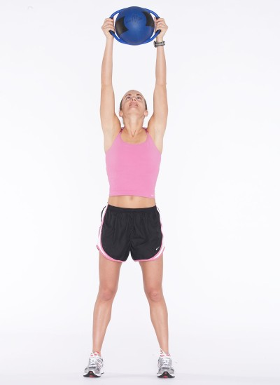 Stretch arms (or ball) straight up overhead, keeping knees soft.