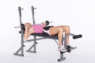 Slowly bend at elbows and lower bar toward chest.