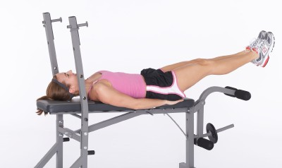 Make sure to keep lower back pressed into bench and slowly lower legs out in front of you.