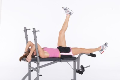 Lower right leg down, keep back pushed into the bench and contract abs.